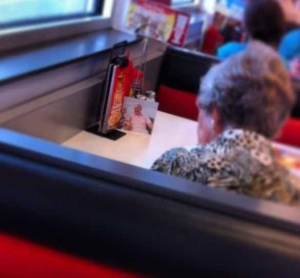 heart-touching-photos-woman-havaing-lunch-with-her-passed-away-husband
